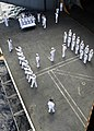 US Navy 050623-N-4166B-033 Seven guns fire from the honor guard during a burial at sea ceremony aboard the Nimitz-class aircraft carrier USS Abraham Lincoln (CVN 72).jpg