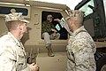 US Navy 060128-N-2568S-027 Brig. Gen. John Wissler (right) and Chief Warrant Officer Tim Callahan explain to Secretary of the Navy (SECNAV) Dr. Donald C. Winter, how the newly designed vehicles are helping to protect Marines.jpg