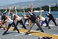 US Navy 060627-N-5290S-109 Gilad of the Fit TV show, Bodies in Motion, films a show aboard the amphibious assault ship USS Bonhomme Richard (LHD 6). Sailors participated in the filming on the flight deck during Rim of the Pacif.jpg