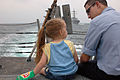 US Navy 060811-N-4014G-406 Information Systems Technician Julio Rocha sits on the deck aboard the guided-missile frigate USS Carr (FFG 52) with his little sister, during a family and friend's day cruise.jpg