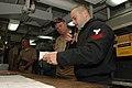 US Navy 060906-N-2659P-125 Aviation Electronics Technician 1st Class Chad Hutchens talks with Vice Adm. Walter Massenburg during the admiral's visit to the Nimitz-class aircraft carrier USS John C. Stennis (CVN 74).jpg