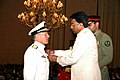 US Navy 070323-O-0000X-001 Pakistan President Pervez Musharraf presents Rear Adm. Michael A LeFever with the Crescent of Great Leader award, in a ceremony held at the Presidential Palace in Islamabad.jpg