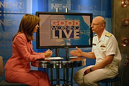 US Navy 070702-N-8110K-002 New England Cable News television anchor, Karen Meyers speaks to Commander, Naval Sea Systems Command, Vice Adm. Paul Sullivan about the Navy's role in the global war on terrorism.jpg