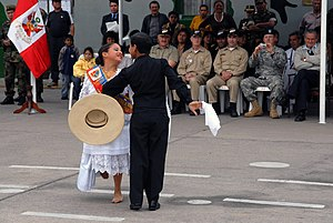 US Navy 070812-N-8704K-269 Lupita Carrion and Alvako Coello perform a dance during a closing ceremony for the Military Sealift Command (MSC) hospital ship USNS Comfort (T-AH 20)