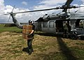 US Navy 070907-N-7540C-063 A U.S. Navy aircrewman carries boxes of food from a U.S. helicopter during disaster relief efforts in Nicaragua.jpg