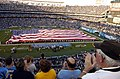 US Navy 080825-N-4420S-129 Service members spread the American flag across Qualcom Stadium.jpg