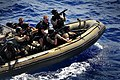 US Navy 090213-N-4774B-167 Members of a visit, board, search, and seizure team assigned to guided-missile cruiser USS Lake Champlain (CG 57) ride a rigid-hull inflatable boat at high speed during a training exercise.jpg