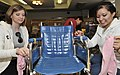 US Navy 090304-N-2638R-003 Personnel Specialist Seaman Recruit Sherrie Downing from Dothan, Ala., left, and Personnel Specialist Seaman Gabriela Moreno, from San Antonio, clean a wheelchair at Yokosuka's Aiko-En Retirement Home.jpg