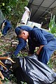 US Navy 090626-N-5586R-098 Sailors assigned to the aircraft carrier USS Ronald Reagan (CVN 76) pick weeds and rake leaves at the Franciscan Missionaries of Mary, House of Prayer and Formation during a community relations (COMRE.jpg