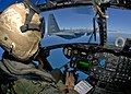 US Navy 090721-N-9950J-236 Marine Capt. Erick Min, assigned to Marine Medium Helicopter Squadron (HMM) 262, pilots a CH-53E Sea Stallion helicopter during an in-flight refueling.jpg