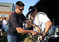 US Navy 090803-N-5366K-122 Aircrew Survival Equipmentman 1st Class Victor Maldonado, assigned to the U.S. Navy parachute team, the.jpg