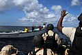 US Navy 091015-N-4154B-051 Members of a visit, board, search and seizure team from the guided-missile cruiser USS Anzio (CG 68) instruct the crewmembers of a vessel to show their hands as the team approaches to conduct a boardi.jpg