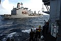 US Navy 100105-N-2600H-014 Sailors aboard USS Chosin (CG 65) stand by as USNS Kanawha (T-AO 196) approaches for a replenishment at sea.jpg