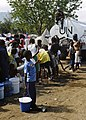 US Navy 100125-N-5345W-199 A Sri Lanka Navy Sailor serving as a U.N. peacekeeper provides security from atop a U.N. water truck as dozens of displaced Haitians wait in line for fresh drinking water at the Lifeline Christian Min.jpg