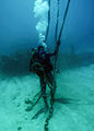 US Navy 100130-N-7917R-012 Navy Diver 1st Class William Davis, assigned to the Port Operations Dive Locker at Naval Station Guantanamo Bay, Cuba, takes slack out of a line .jpg