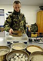 US Navy 100315-N-1120L-012 Engineering Aide Constructionman Christopher Kumpf, a Seabee assigned to Naval Mobile Construction Battalion (NMCB) 7., weighs soil samples.jpg