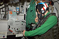 US Navy 100519-N-5095K-002 Aircrew Survival Equipmentman Airman Blaze Moore performs maintenance.jpg