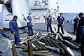 US Navy 101027-N-8913A-415 Sailors aboard the guided-missile destroyer USS Mitscher (DDG 57) recover 5-inch Mark 45-54-caliber lightweight gun casi.jpg