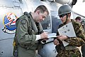 US Navy 110314-N-OB360-002 Lt. Jacob King, assigned to the Chargers of Helicopter Anti-Submarine Squadron (HS) 14, signs for fuel received from the.jpg