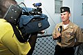 US Navy 110805-N-QY430-082 Fire Controlman 1st Class Joshua Gawdin talks to channel 3 news after a ceremony commemorating the 2,000th combat launch.jpg