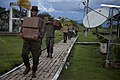 US Navy 111010-A-ZZ999-021 Marines assigned to 2nd Assault Amphibian Battalion, Ground Combat Element, carry in supplies after landing in a trainin.jpg