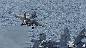 US Navy 120216-N-VO377-172 An F-A-18C Hornet assigned to the Vigilantes of Strike Fighter Squadron (VFA) 151 launches from the flight deck of the.jpg