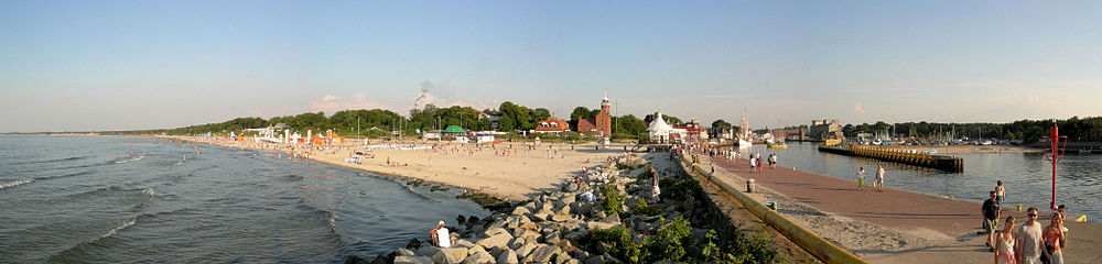 Panoramic view of beach and port in Ustka seen from pier