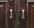 Via san gallo 128, edifici poggiani su via della libertà, portale 03 maniglie.jpg