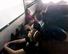 Students sitting on the floor.