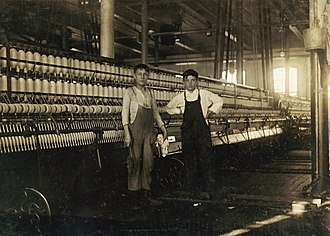 1928 New Bedford textile strike - Boy operatives in the mule room of the Wamsutta Mill in New Bedford, January 1912, as photographed by anti-child labor activist Lewis Hine (1874-1940).