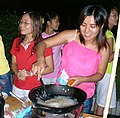 Wok cooking woman at food festival by peiqianlong.jpg