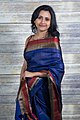 Woman wearing sari (39788385540).jpg