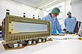 Worker checks laptop for CubeSat software issues in the SSPF.jpg
