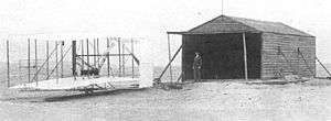 Hangar - The Wright Flyer outside the aircraft's makeshift hangar