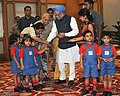 Young children tying 'Rakhi' to the Prime Minister, Dr. Manmohan Singh, on the occasion of 'Raksha Bandhan', in New Delhi on August 05, 2009.jpg