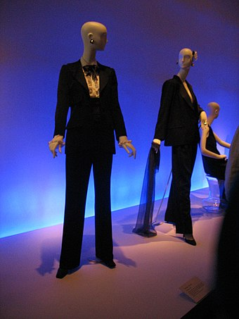 Examples of Saint Laurent's trend-setting Le Smoking evening trouser-suit for women. Yves St Laurent le smoking at deYoung Museum San Francisco.jpg