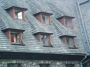 Roof shingle - A shingle roof in Zakopane, Poland. With an area of 6000 m² it was one of the largest wooden shingle roofs in Europe.