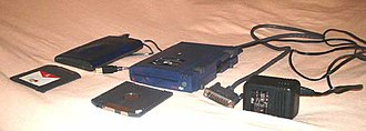 Zip drive - Later (USB, left) and earlier (parallel, right) Zip drives (media in foreground).
