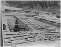 """Stewart Mountain spillway. View looking downstream along supported floor 3-4, with floors 2-3 and 4-5 not poured."" - NARA - 294629.tif"