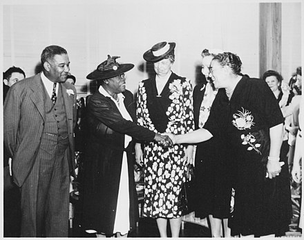 "Eleanor Roosevelt and Mary McLeod Bethune, a member of Roosevelt's Black Cabinet (a key advisory group on race relations) (Mary McLeod Bethune), ""Mrs. Eleanor Roosevelt and others at the opening of Midway Hall, one of two residence halls buil - NARA - 533032.jpg"