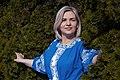 День Вишиванки. Молода україночка у вишитій синій сукні серед квітів 12.jpg