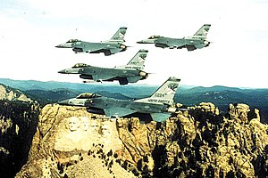 175th Fighter Squadron - 4 ship F-16s over Mount Rushmore.jpg