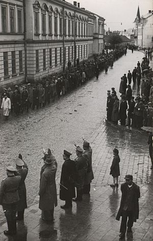 14th Waffen Grenadier Division of the SS (1st Galician) - SS Galizien volunteers march on Kosciuszko Street in Sanok, 1943 May