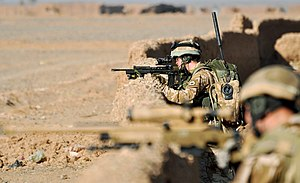 Royal Welsh - Soldiers from the Mobility Reconnaissance Force of 1 Royal Welsh take up a defensive position north of Patrol Base Wahid, Nad-E' Ali, Helmand during a patrol.