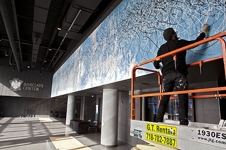 Jose Parla painting a mural titled Diary of Brooklyn at Barclay's Center 2013 Parla working at Barclays Center.jpg