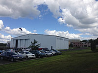 2014-08-24 13 15 57 Skydivers parachuting to the ground at Pennridge Airport in East Rockhill Township, Pennsylvania.JPG
