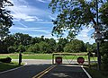 2016-08-19 11 30 10 View south at the south end of Maryland State Route 980 (Southern Maryland Boulevard Service Road) at a gate in Lyons Creek, Anne Arundel County, Maryland.jpg