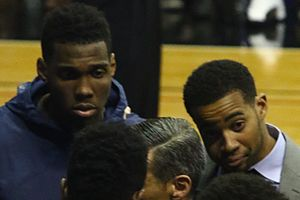 Phil Booth (basketball) - Sidelined guys during 2016–17 Villanova Wildcats men's basketball team huddle, including Booth (right)