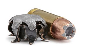 .40S&W cartridge next to expanded hollow point...