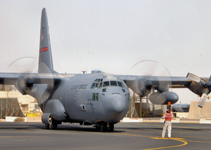 777th Expeditionary Airlift Squadron - A C-130 Hercules if the 777th Expeditionary Airlift Squadron is marshaled into position at Joint Base Balad, Iraq